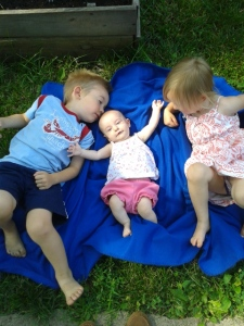 Loved by her big brother and sister